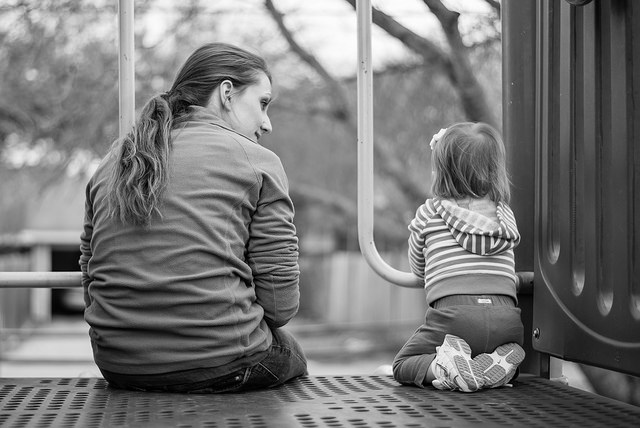 mom and daughter talk playground